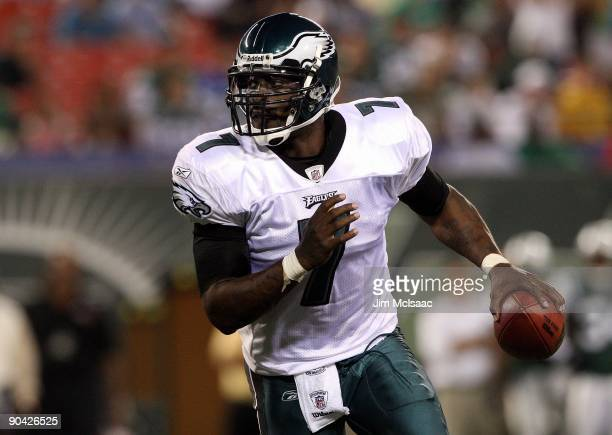 Michael Vick of the Philadelphia Eagles looks to throw a pass against the New York Jets on September 3, 2009 at Giants Stadium in East Rutherford,...