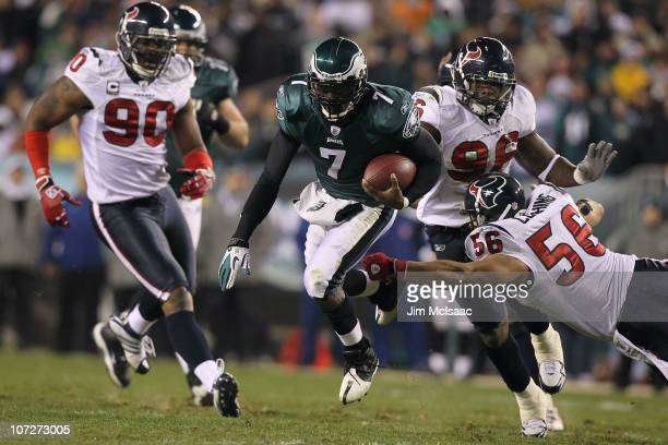 Michael Vick of the Philadelphia Eagles runs the ball against Brian Cushing of the Houston Texans at Lincoln Financial Field on December 2 2010 in...