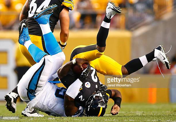Michael Vick of the Pittsburgh Steelers is tackled by Kawann Short of the Carolina Panthers in the first quarter during the game at Heinz Field on...