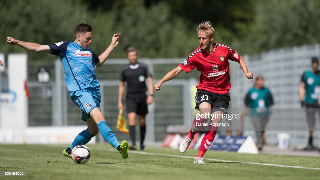 Michael Vitzthum of Grossaspach (R) is challenged by Marcel Baer of Aalen during the 3. Liga match between SG Sonnenhof Grossaspach and VfR Aalen at on August 19, 2017 in Grossaspach, Germany.