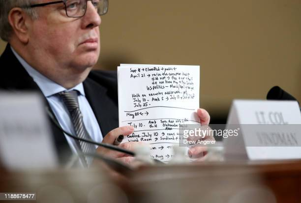 Michael Volkov attorney for Lt Col Alexander Vindman National Security Council Director for European Affairs holds a stack of notes as Vindman...