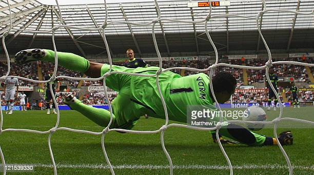 Michael Vorm of Swansea City saves the penalty kick from Ben Watson of Wigan during the Barclays Premier League match between Swansea City and Wigan...
