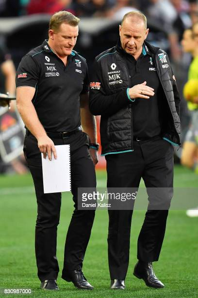 Michael Voss midfield manager of the Power and Ken Hinkley the coach of the Power walk from the ground during the round 21 AFL match between Port...