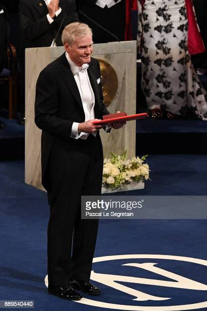 Michael W Young laureate of the Nobel Prize in physiology or medicine aknowledges applause after he received his Nobel Prize from King Carl XVI...