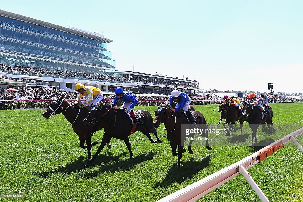 Michael Walker rides Comin' Through to win race one, the Carbine Club Stakes on Derby Day at Flemington Racecourse on October 29, 2016 in Melbourne, Australia.