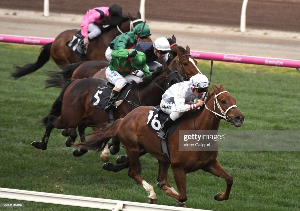 Michael Walker riding Alward wins Race 8 during Melbourne Racing at Flemington Racecourse on August 12, 2017 in Melbourne, Australia.