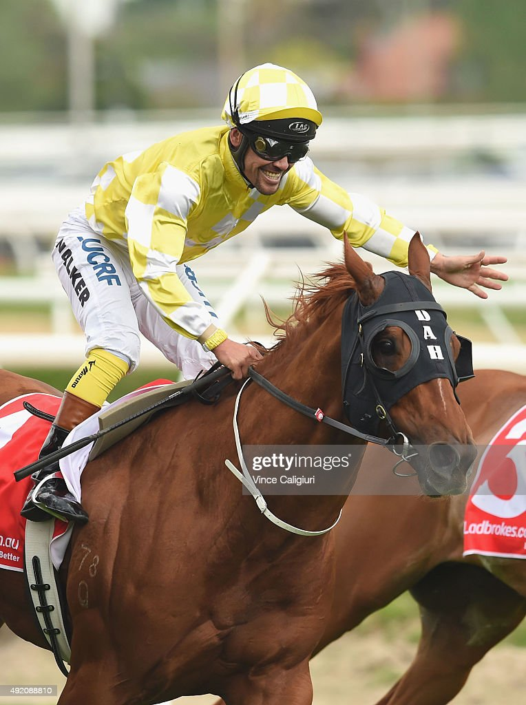 Michael Walker riding Criterion reacts after defeating Happy Trails and Opie Bosson riding Mongolian Khan (L) in Race 6, the Ladbrokes Caulfield Stakes during Caulfield Guineas Day at Caulfield Racecourse on October 10, 2015 in Melbourne, Australia.