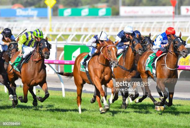 Michael Walker riding Harlem defeats Mark Zahra riding Gailo Chop and Damien Oliver riding Almandin in Race 8 TAB Australian Cup during Melbourne...