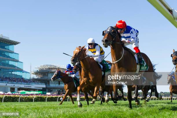 Michael Walker riding Harlem defeats Mark Zahra riding Gailo Chop in Race 8 TAB Australian Cup during Melbourne Racing at Flemington Racecourse on...