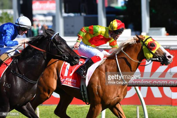 Michael Walker riding Mighty Boss defeats Damian Lane riding Kementari in Race 8 Ladbrokes Caulfield Guineas during Melbourne Racing on Caulfield...