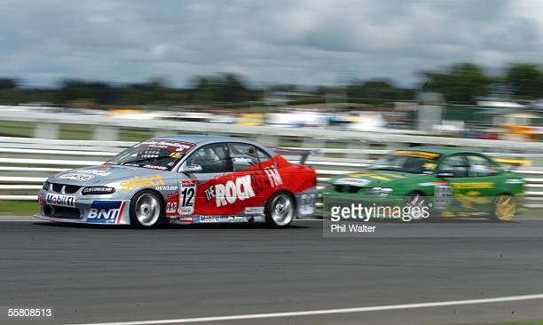 Michael Wallace from Dunedin in his Holden Commodore VX leads Miles Pope from Auckland in his Holden Commodore VX during the days second race of the...