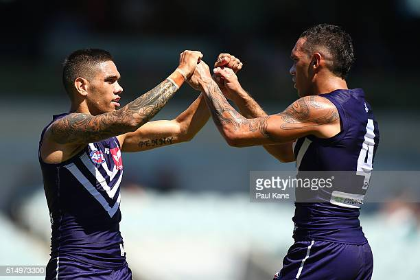 Michael Walters and Harley Bennell of the Dockers celebrates a goal during the NAB Challenge match between the Fremantle Dockers and the Geelong Cats...
