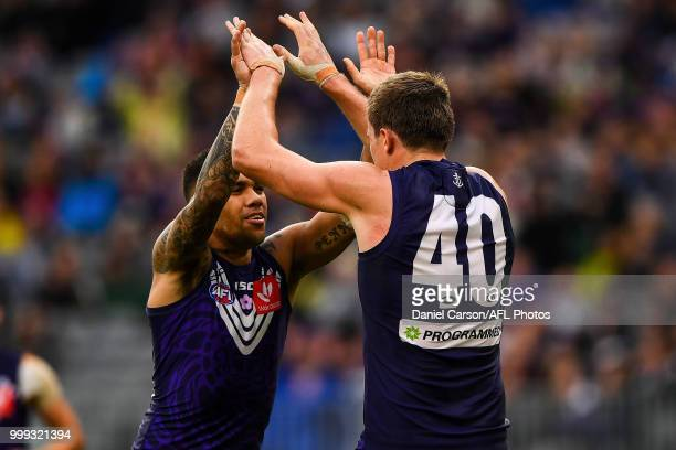 Michael Walters and Scott Jones of the Dockers celebrates a goal during the 2018 AFL round 17 match between the Fremantle Dockers and the Port...