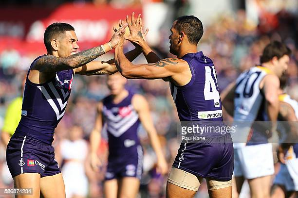 Michael Walters and Shane Yarran of the Dockers celebrate a goal during the round 20 AFL match between the Fremantle Dockers and the West Coast...