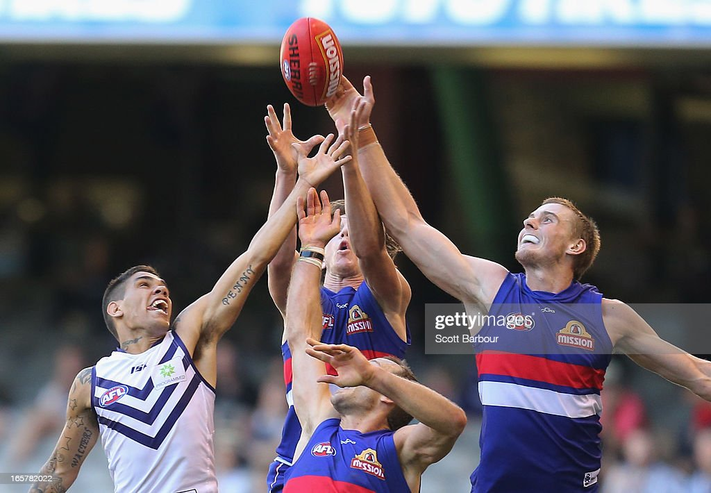 Michael Walters of the Dockers and Daniel Cross of the Bulldogs compete for the ball during the round two AFL match between the Western Bulldogs and the Fremantle Dockers at Etihad Stadium on April 6, 2013 in Melbourne, Australia.