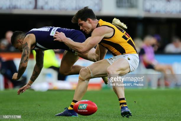 Michael Walters of the Dockers and Jaeger O'Meara of the Hawks go for the ball during the round 19 AFL match between the Fremantle Dockers and the...