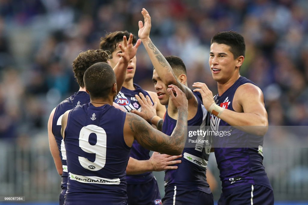 Michael Walters of the Dockers celebrates a goal during the round 17 AFL match between the Fremantle Dockers and the Port Adelaide Power at Optus Stadium on July 15, 2018 in Perth, Australia.