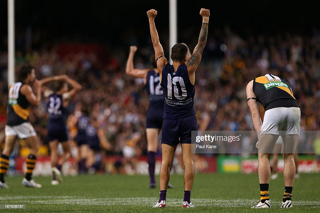 Michael Walters of the Dockers celebrates winning as Jake Batchelor looks on during the round five AFL match between the Fremantle Dockers and the Richmond Tigers at Patersons Stadium on April 26, 2013 in Perth, Australia.