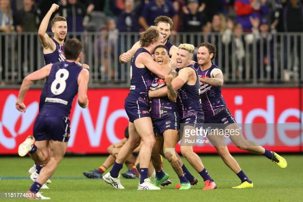 Michael Walters of the Dockers celebrates with team mates after kicking the winning point after the siren during the round 10 AFL match between the...