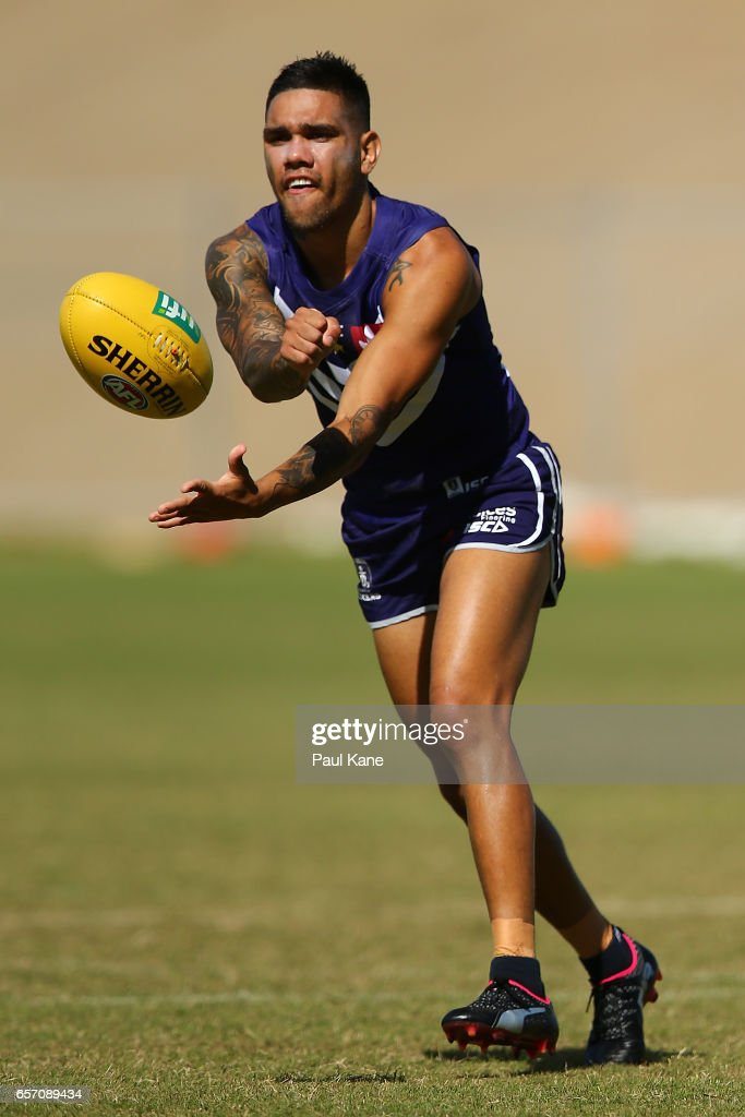 Michael Walters of the Dockers handballs during a Fremantle Dockers AFL training session at Victor George Kailis Oval on March 24, 2017 in Perth, Australia.