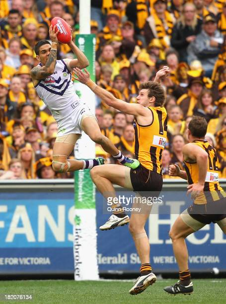 Michael Walters of the Dockers marks over the top of Grant Birchall of the Hawks during the 2013 AFL Grand Final match between the Hawthorn Hawks and...