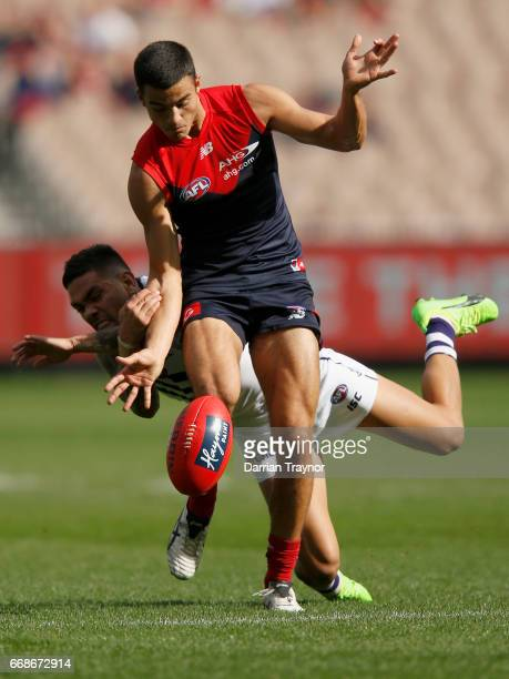 Michael Walters of the Dockers tackles Billy Stretch of the Demons during the round four AFL match between the Melbourne Demons and the Fremantle...