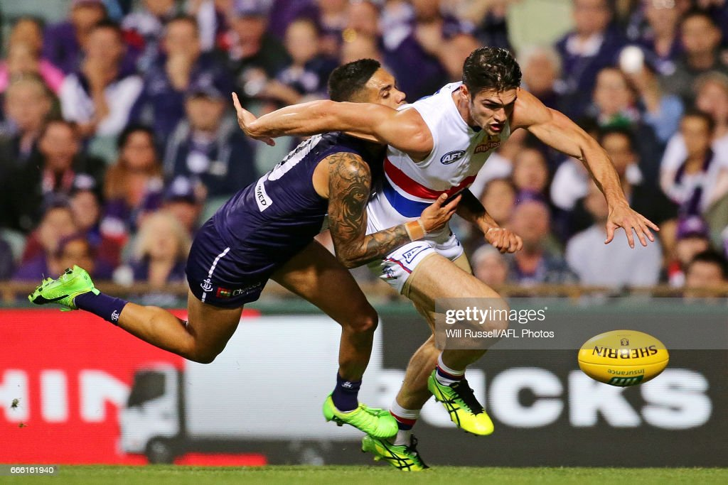 Michael Walters of the Dockers tries to tackle Easton Wood of the Bulldogs during the round three AFL match between the Fremantle Dockers and the Western Bulldogs at Domain Stadium on April 8, 2017 in Perth, Australia.