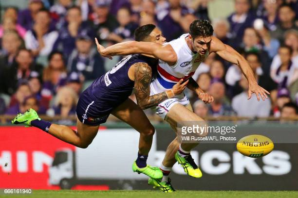 Michael Walters of the Dockers tries to tackle Easton Wood of the Bulldogs during the round three AFL match between the Fremantle Dockers and the...