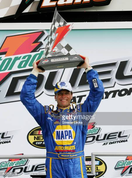 Michael Waltrip celebrates with the Gatorade Duel Trophy after winning the first Gatorade Duel race at the NASCAR Nextel Cup Daytona 500 February 17...