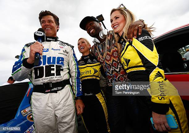 Michael Waltrip driver of the BlueDEF/AAA Toyota stands with Curtis '50 Cent' Jackson and Miss Sprints Kim Coon and Brooke Werner during the NASCAR...