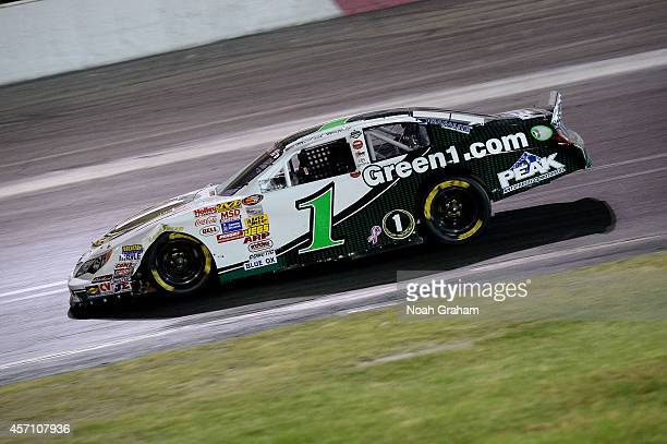 Michael Waltrip driver of the Green Toyota drives during the NASCAR KN Toyota/NAPA Auto Parts 150 at the All American Speedway on October 11 2014 in...