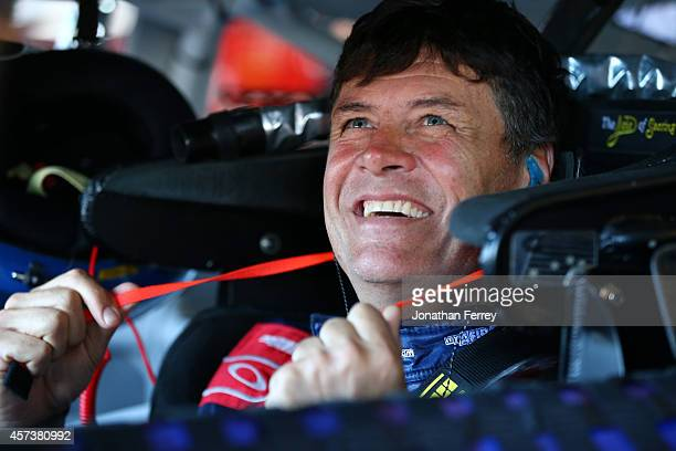 Michael Waltrip driver of the MyAFibStorycom Toyota prepares to drive during practice for the NASCAR Sprint Cup Series GEICO 500 at Talladega...