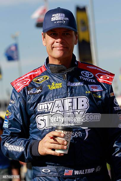Michael Waltrip driver of the MyAFibStorycom Toyota stands on the grid during qualifying for the NASCAR Sprint Cup Sereies GEICO 500 at Talladega...
