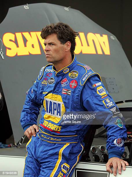 Michael Waltrip driver of the Napa Auto Parts Chevolet waits in the garage area during NASCAR NEXTEL Cup testing at the Daytona International...