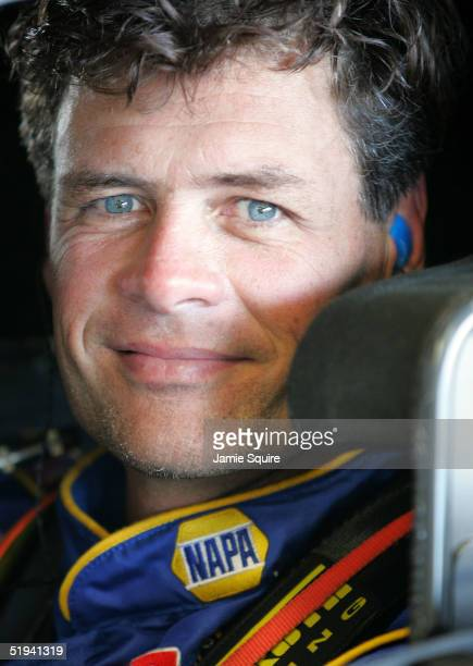 Michael Waltrip driver of the Napa Auto Parts Chevrolet waits in the garage area during NASCAR NEXTEL Cup testing at the Daytona International...