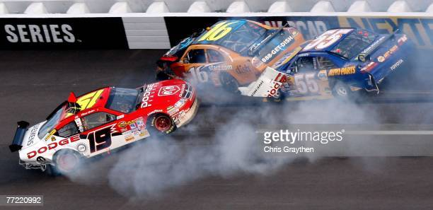 Michael Waltrip driver of the NAPA Auto Parts Toyota loses control and crashes into Elliott Sadler driver of the Dodge Dealers/UAW Dodge and Greg...