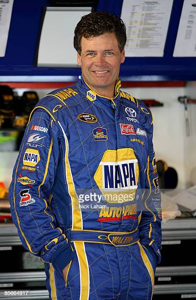 Michael Waltrip driver of the NAPA Auto Parts Toyota stands in the garage during practice for the NASCAR Sprint Cup Series Goody�s Fast Pain Relief...