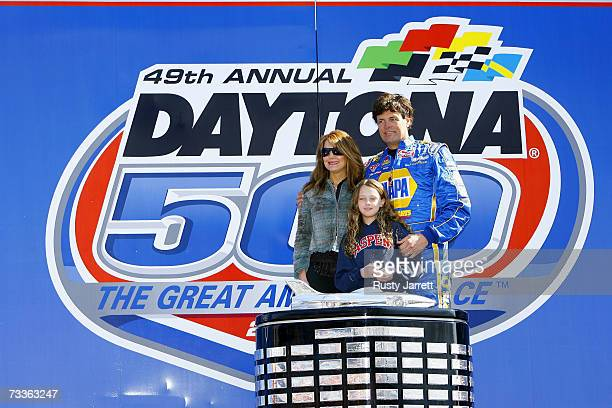 Michael Waltrip driver of the NAPA Dodge stands with his wife Buffy Waltrip and daughter Macy prior to the NASCAR Nextel Cup Series Daytona 500 at...