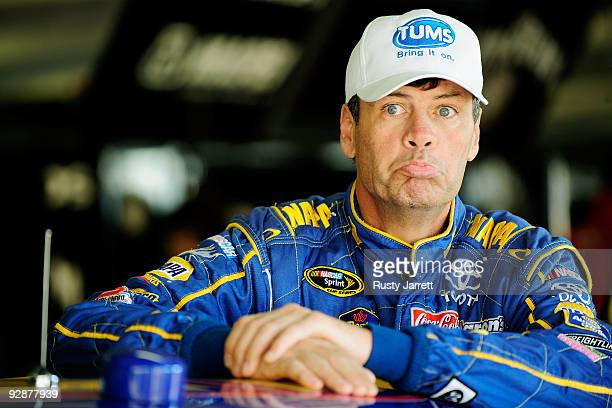 Michael Waltrip driver of the NAPA Toyota stands in the garage prior to practice for the NASCAR Sprint Cup Series Dickies 500 at Texas Motor Speedway...