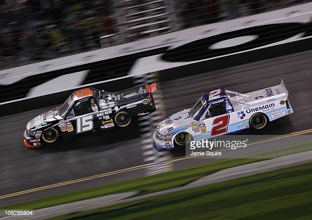 Michael Waltrip driver of the Wounded Warrior Project Toyota crosses the finish line in front of Elliott Sadler driver of the OneMain Financial...