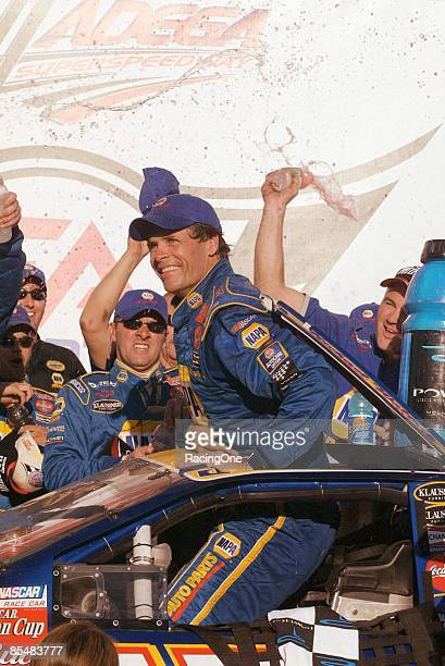 Michael Waltrip exits his NAPA Chevrolet through the roof hatch in victory lane for the EA Sports 500 It was his 4th career win Waltrip started the...
