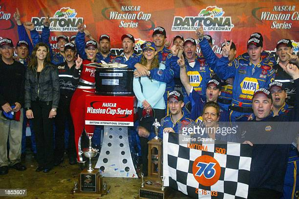 Michael Waltrip holds his wife Buffy as his DEI NAPA Auto Parts crew celebrate his second victory at the NASCAR Winston Cup Daytona 500 on February...