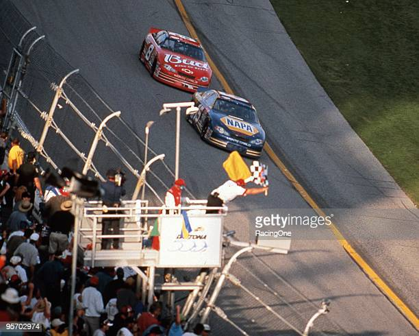 Michael Waltrip nips Dale Earnhardt Jr at the finish line for his first of two Daytona 500 victories