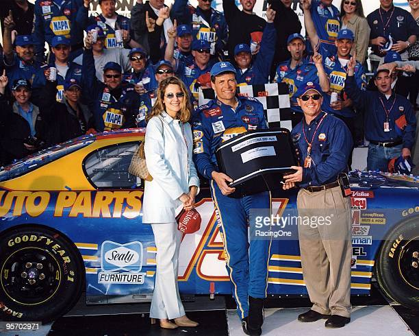 Michael Waltrip overcame Dale Earnhardt Jr to win the Daytona 500 as he holds the Harley J Earl trophy in victory lane Earnhardt Jr's father and...