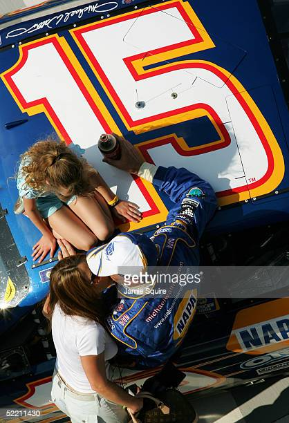 Michael Waltrip receives a kiss from his wife Buffy as daughter Margaret sits on top of the victorious DEI NAPA Auto Parts 500 after he won the first...