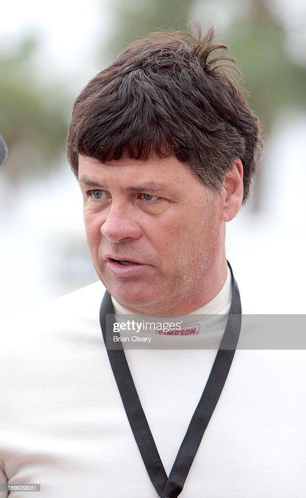 Michael Waltrip stands in the paddock during preseason testing at Daytona International Speedway on January 5, 2013 in Daytona Beach, Florida.