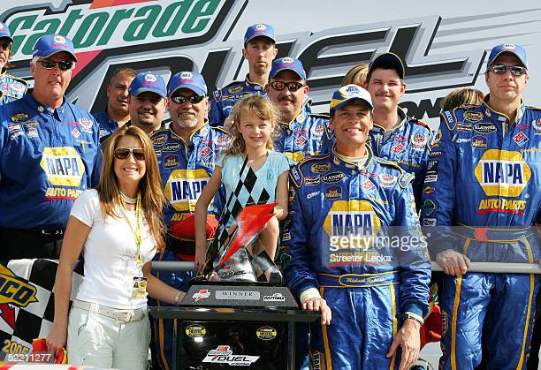 Michael Waltrip stands with his wife Buffy daughter Margaret and members of the victorious DEI NAPA Auto Parts Chevrolet after winning the first...