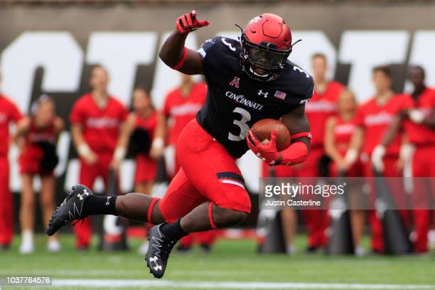 Michael Warren II of the Cincinnati Bearcats celebrates with his team after a touchdown in the game against the Ohio Bobcats at Nippert Stadium on...