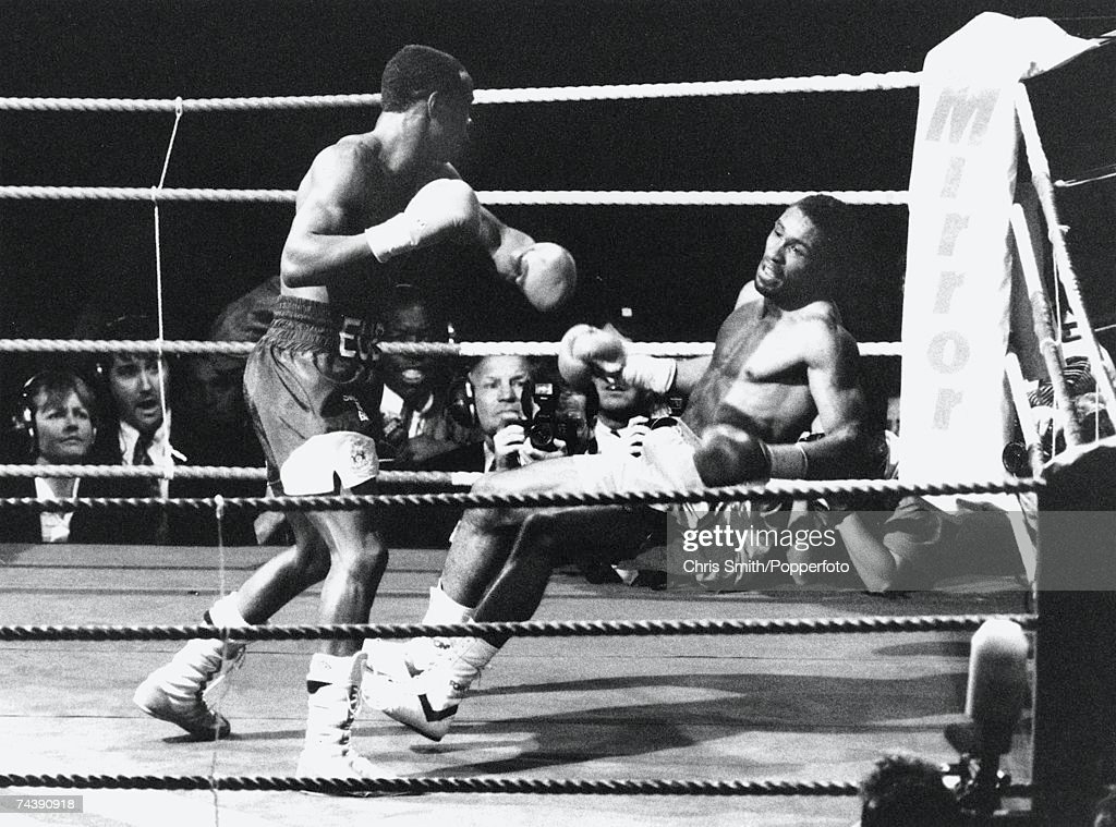Michael Watson falls after Chris Eubank delivers the final punch in their WBO super-middleweight fight at White Hart Lane, 21st September 1991. The fight ended Watson's career but lead to safety procedure changes.