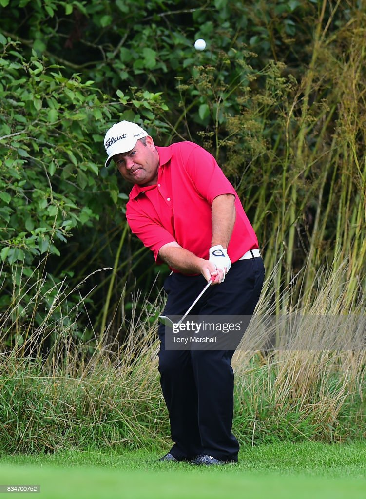Michael Watson of Wessex Golf Centre chips on to the 6th green during the Golfbreaks.com PGA Fourball Championship - Day 3 at Whittlebury Park Golf & Country Club on August 18, 2017 in Towcester, England.